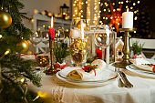 Beautiful served table with Christmas decorations, candles and lanterns