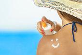 Woman applying Sun protection on her skin