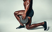 Healthy man exercising with weights