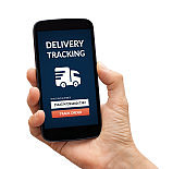 Hand holding smart phone with delivery tracking concept on screen