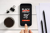Black Friday concept on smart phone screen with office objects
