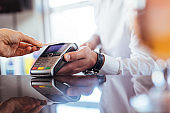 Customer using NFC technology for payment at bar