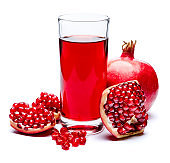Pomegranate juice and seeds close-up
