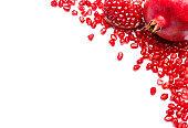 frame of Pomegranate seeds on white background