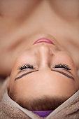 woman in spa salon lying and enjoy