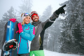 couple snowboarder enjoying at ski resort in the mountain