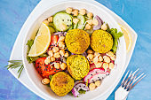 Baked falafel salad with vegetables and sprouted chickpeas