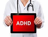 Doctor showing digital tablet screen