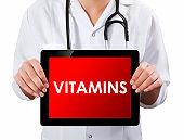 Doctor showing digital tablet screen.Vitamins