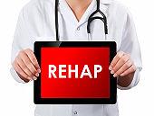 Doctor showing digital tablet screen.Rehap