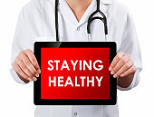 Doctor showing digital tablet screen.Staying Healthy