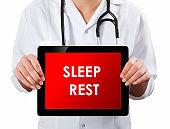 Doctor showing digital tablet screen.Sleep Rest