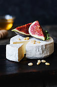 Brie or camambert cheese with figs, honey and pine nuts