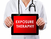 Doctor showing digital tablet screen.Exposure theraphy