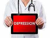 Doctor showing digital tablet screen.Depression