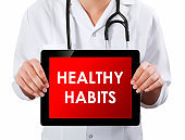 Doctor showing digital tablet screen.Healthy Habits