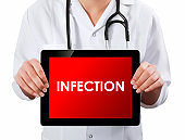 Doctor showing digital tablet screen.Infection
