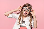 Excited girl in creative sunglasses