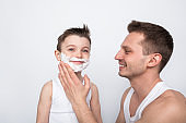 Father teaching boy to shave