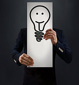 Genius Businessman Holding Idea Bulb Symbol