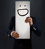 Businessman Showing Laughing Emoji Board