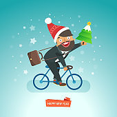Happy Businessman riding a bicycle in Santa Claus red hat