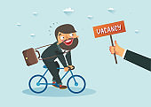 Man riding a bicycle towards Vacancy announcement