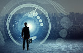 business person back view and futuristic interface, smart city, internet of things, information communication technology, abstract image visual