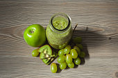 Fresh kiwi smoothie with apple and grapes in a bottle. Healthy eating concept Selective focus. Detox, diet food, vegetarian.
