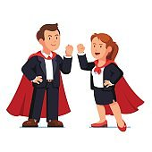 Superhero business man and woman in red capes