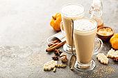 Pumpkin spice latte in tall mugs