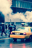 Taxi cab and pedestrians crossing in New York City