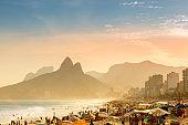 People sunbathe on Ipanema beach