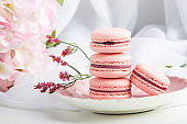 Pink strawberry macarons. French delicate dessert for Breakfast