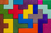 Background with different colorful shapes wooden blocks