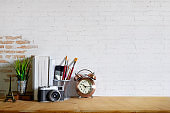 Mock up modern home decor with camera, dummy, houseplant. Artist workspace with copy space for products display montage.