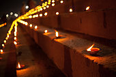 Dev Deepawali festival - Earthen lamps are lit on the stairs leading to the Ganges