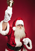 santa claus ringing bell and pointing finger