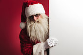 santa claus showing a big blank board