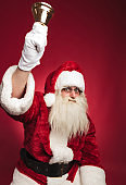 santa claus ringing his bell with hand in the air