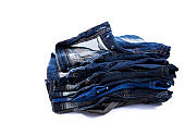Jeans stacked on background