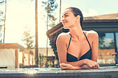Young woman in the swimming pool rest