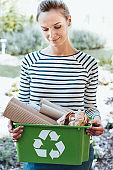 Satisfied housewife using recycling ecosystem