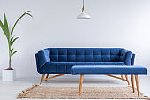 Quilted blue sofa and bench