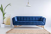 Blue sofa and wicker carpet