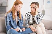 Woman comforting sad depressed sister
