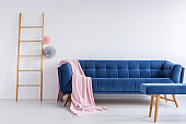 Blue sofa in white room