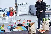 Man in messy nursery