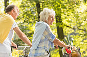 Mature woman cycling in park