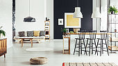 Retro dining room with pouf